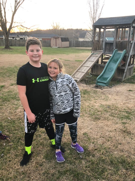 Daniel Unthank and his sister Evelyn sport shorts with leggings and compression pants underneath. Daniel wears shorts year round along with many of his male friends and classmates.