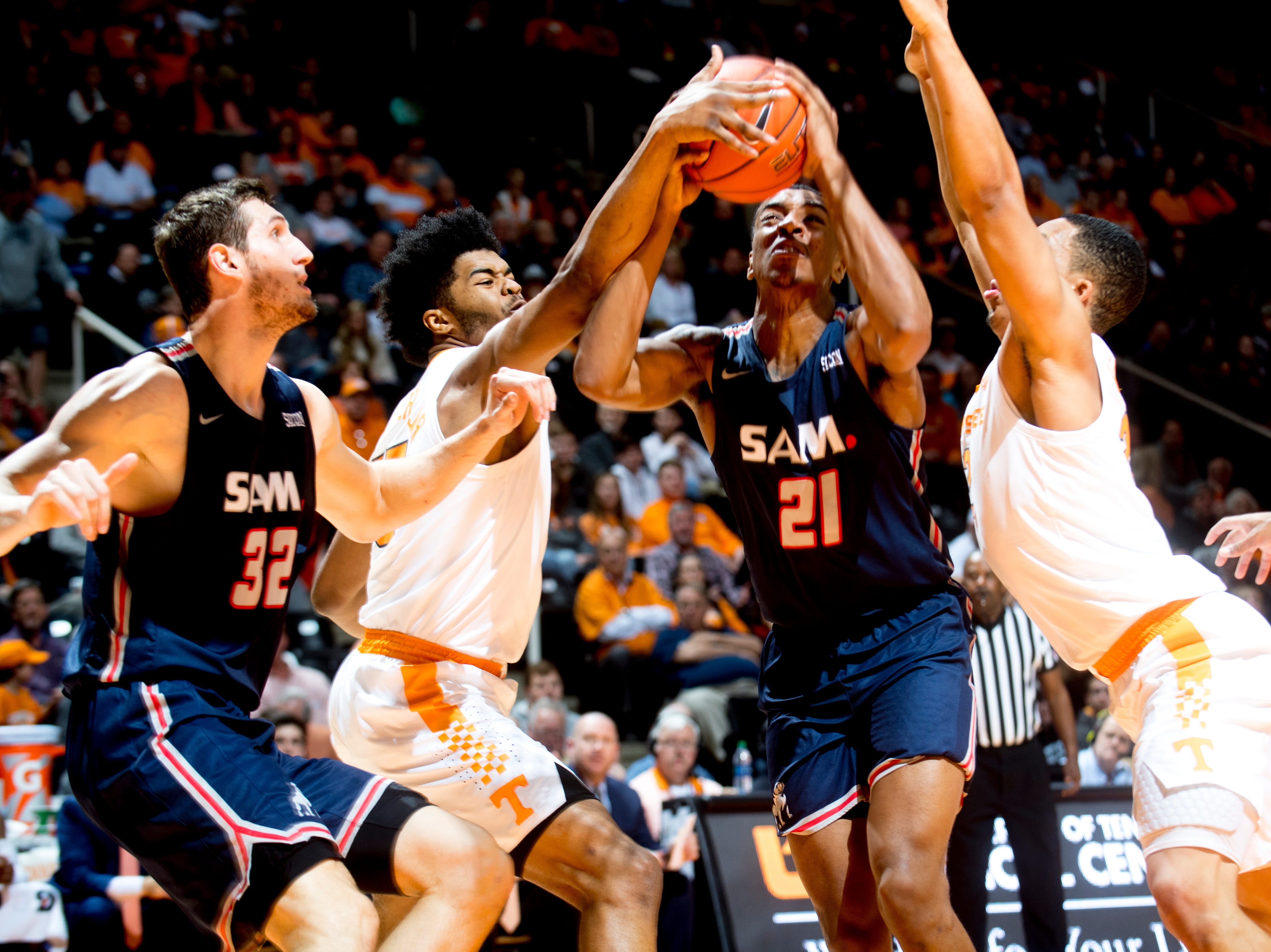Samford forward Robert Allen (21) goes for a layup during a game between Tennessee and Samford at Thompson-Boling Arena in Knoxville, Tennessee on Wednesday, December 19, 2018.