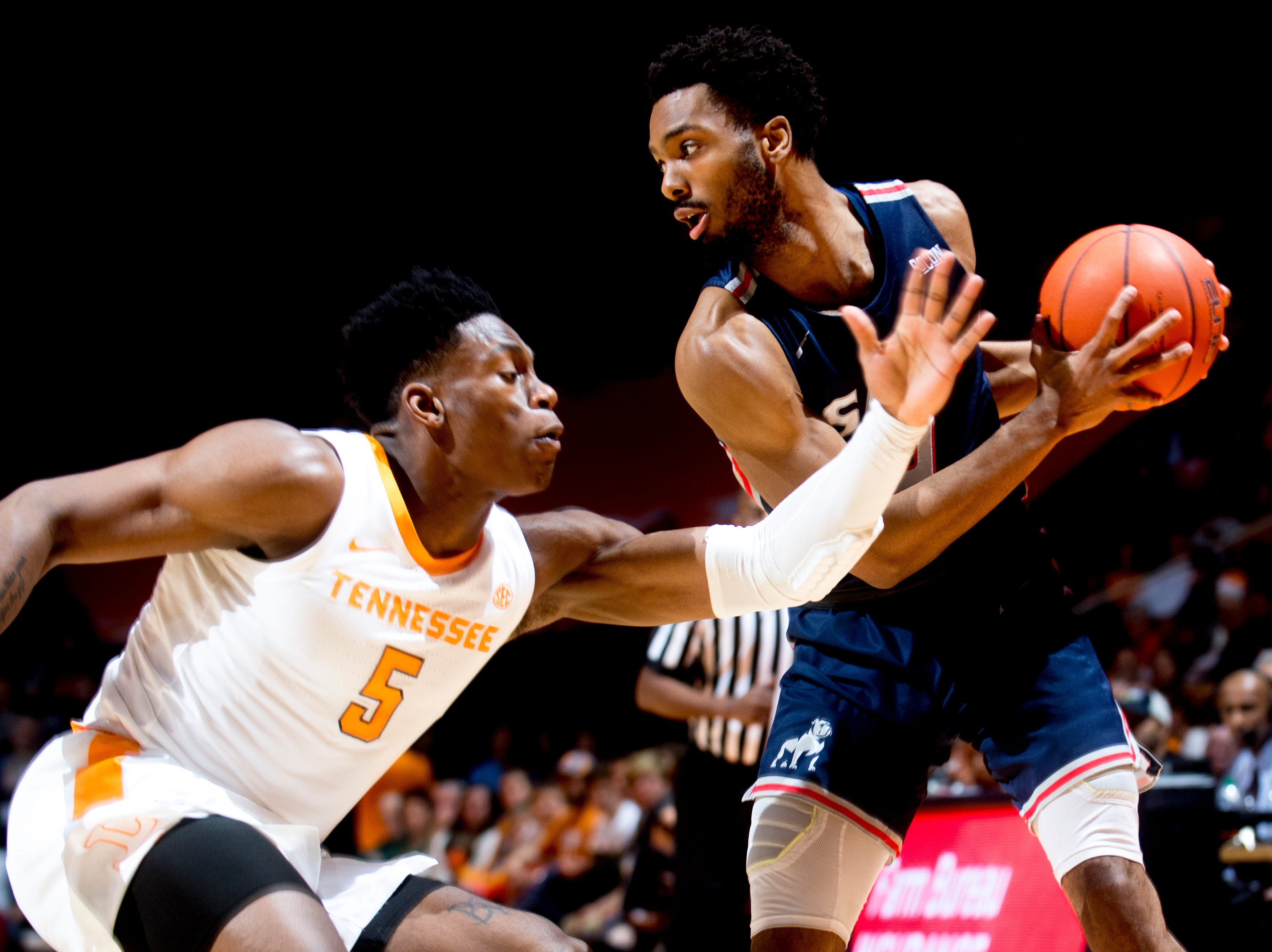 Tennessee guard Admiral Schofield (5) defends against Samford guard Myron Gordon (4) during a game between Tennessee and Samford at Thompson-Boling Arena in Knoxville, Tennessee on Wednesday, December 19, 2018.