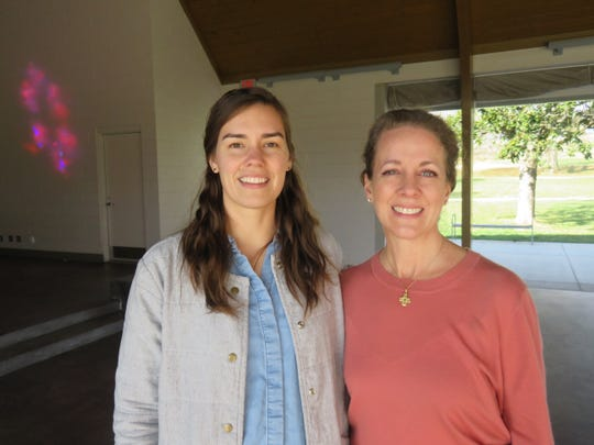 Emily Haire, left, of Johnson Architecture, and Cardin Bradley of Lakeshore Park stand in front of the park's Marble Hall, which was recently recognized with an East Tennessee Preservation Award from Knox Heritage for its unique renovation that converted it into an easily accessible pavilion.