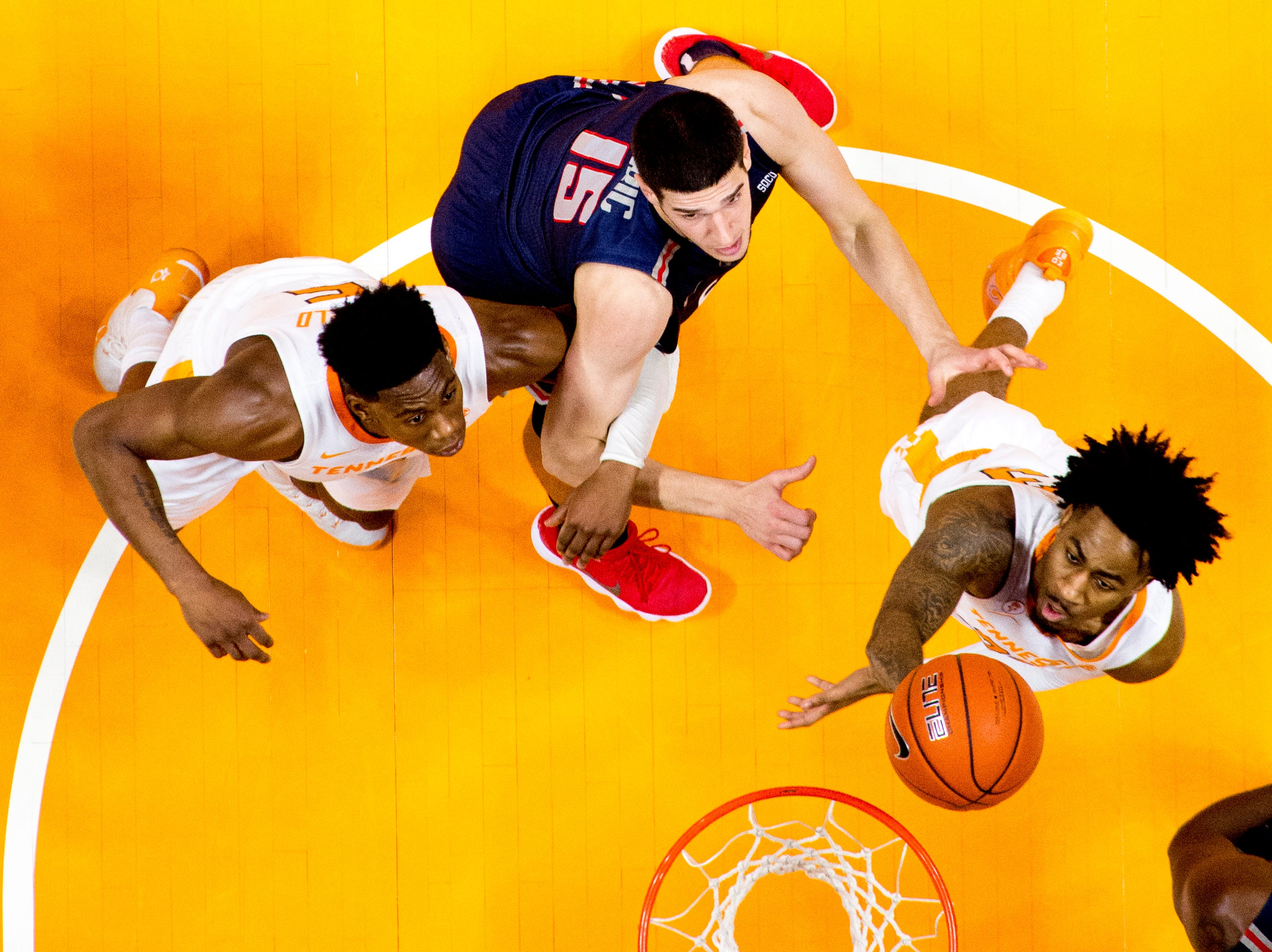 Tennessee guard Jordan Bowden (23) shoots the ball as Samford forward Stefan Lakic (15) defends during a game between Tennessee and Samford at Thompson-Boling Arena in Knoxville, Tennessee on Wednesday, December 19, 2018.