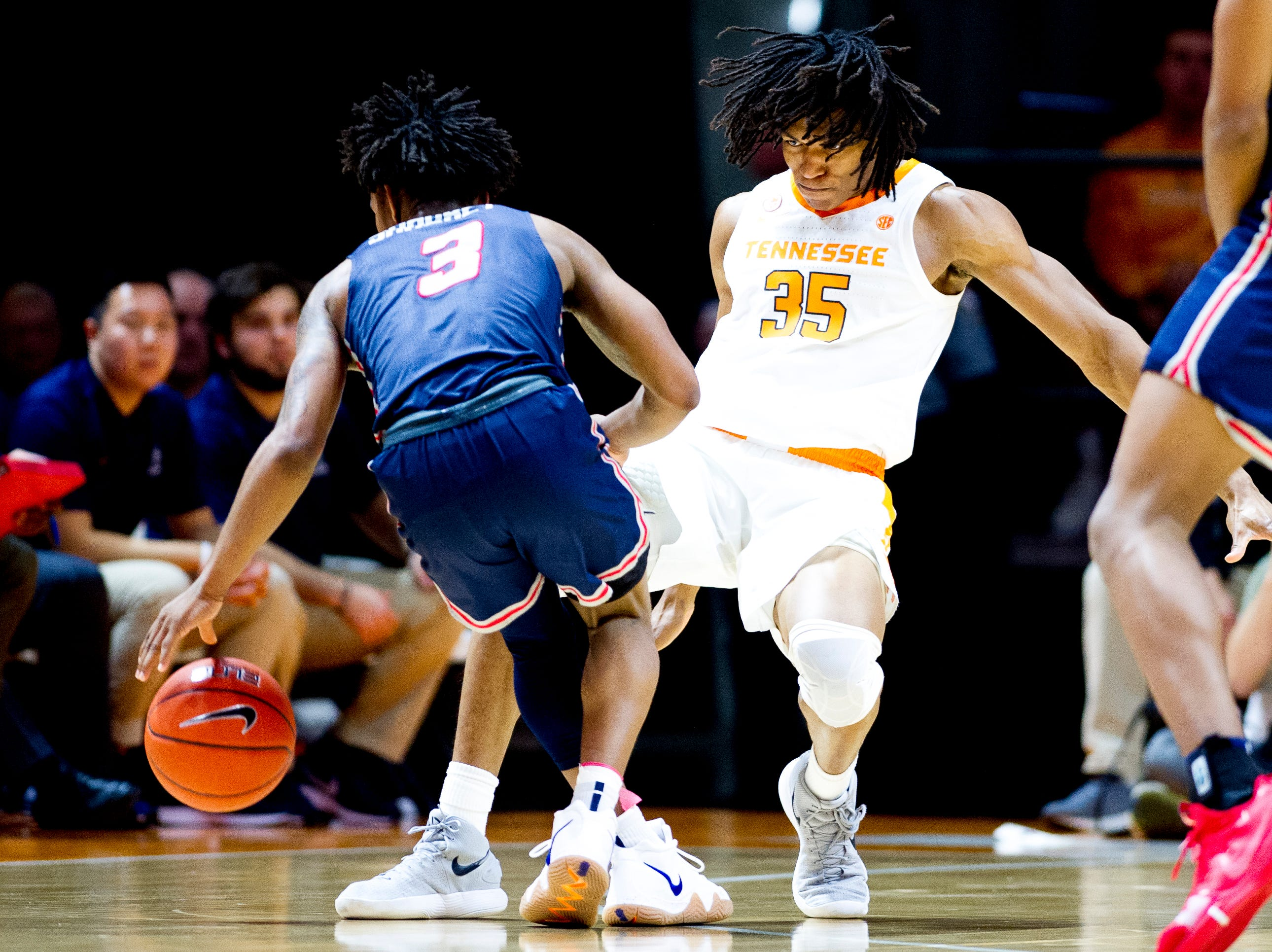 Tennessee guard/forward Yves Pons (35) is knocked over by Samford guard Josh Sharkey (3) during a game between Tennessee and Samford at Thompson-Boling Arena in Knoxville, Tennessee on Wednesday, December 19, 2018.