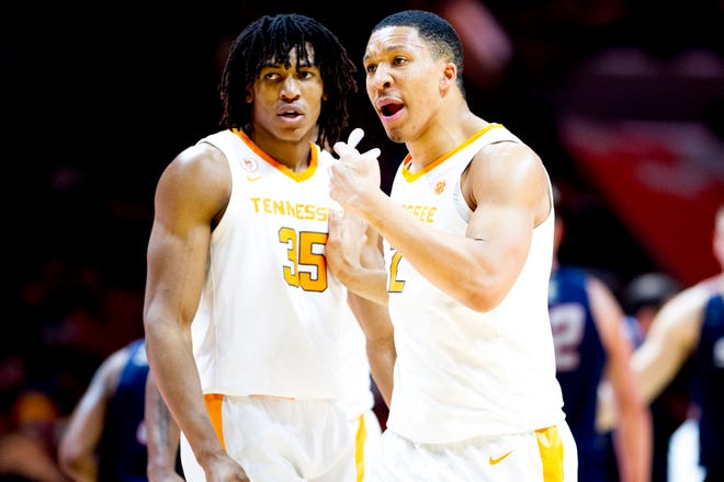 Tennessee forward Grant Williams (2) and Tennessee guard/forward Yves Pons (35) huddle with team members during a time out during a game between Tennessee and Samford at Thompson-Boling Arena in Knoxville, Tennessee on Wednesday, December 19, 2018.