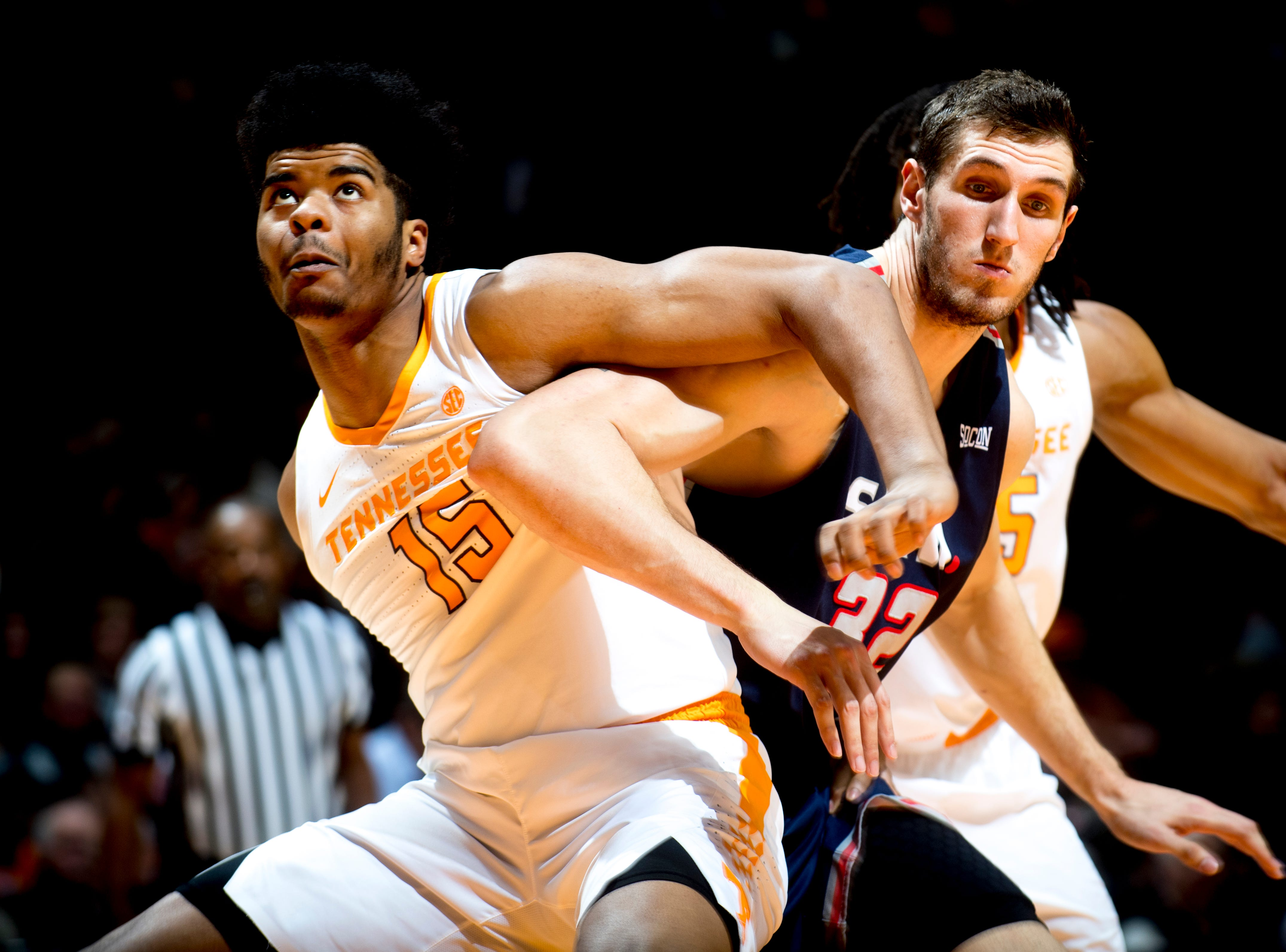 Tennessee forward Derrick Walker (15)  and Samford forward Logan Dye (22) battle for the rebound during a game between Tennessee and Samford at Thompson-Boling Arena in Knoxville, Tennessee on Wednesday, December 19, 2018.