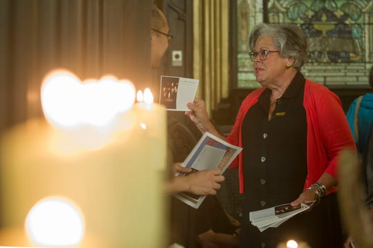 Member of St. John's Lutheran Church, Ruthie Kuhlman, of Knoxville, passes out bulletins to attendees of a service held in response to the Orlando massacre and other recent shootings, on Tuesday, July 12, 2016. (CAITIE MCMEKIN / NEWS SENTINEL)
