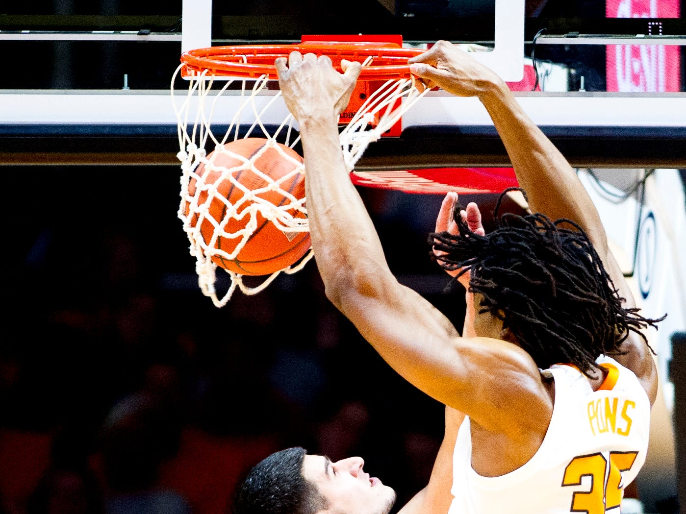 Tennessee guard/forward Yves Pons (35) dunks past Samford forward Stefan Lakic (15) during a game between Tennessee and Samford at Thompson-Boling Arena in Knoxville, Tennessee on Wednesday, December 19, 2018.