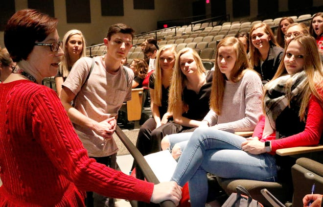 Caroline Toler, left, a Spanish teacher at Fairfield Union High School, talks with members of the schools student council Thursday afternoon, Dec. 20, 2018, about their recent shopping trip with children from Bremen and Pleasantville elementary schools. Student council members raised money and collected donations to take 26 elementary students shopping for Christmas.