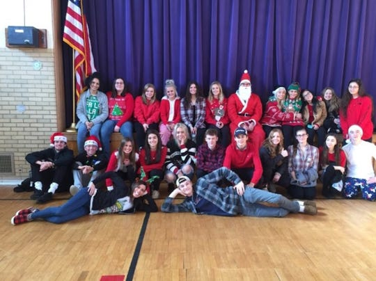 Brighton High School students in Danielle Grill's algebra applications class brought the merry in Christmas to Ford Early Learning Center in Ypsilanti Dec. 17, giving every child at the school a gift.