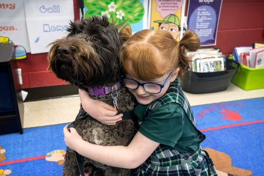 St. Patrick student Hadley Jo Lange has a friend and protector in her service dog Ariel. Dec. 11, 2018
