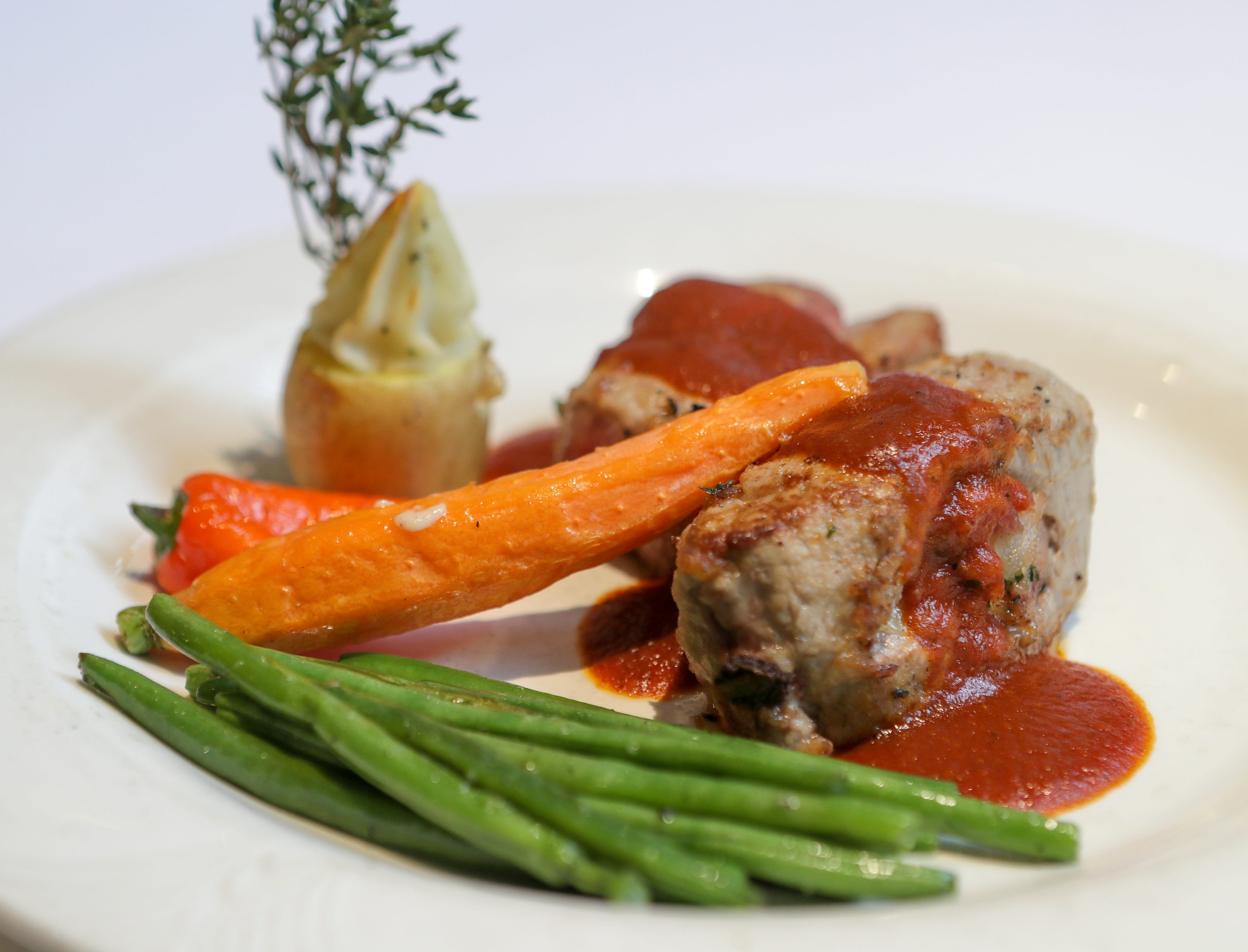 Filetto Di Vitello Al Madeira at Vincenzo'sMedallion of veal stuffed with smoked Gouda and pancetta in a Madeira wine sauce.December 19, 2018