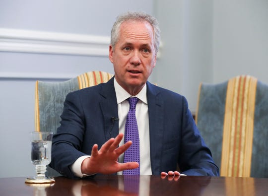 Mayor Greg Fischer is defending the proposed insurance premium tax hike's effect on business in Louisville.