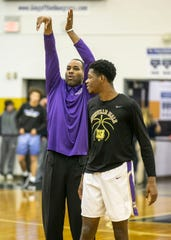 Derek Anderson works with Male players before Wednesday's King of the Bluegrass tournament game.