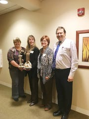 Suzanne Wendorf, Finance Department, was chosen for the Service Excellence Star Award for the month of November at Manitowoc's Felician Village. From left: Jennifer King, business office manager; Wendorf; Joanne Bartz, director of finance; and Frank Soltys, president/CEO.