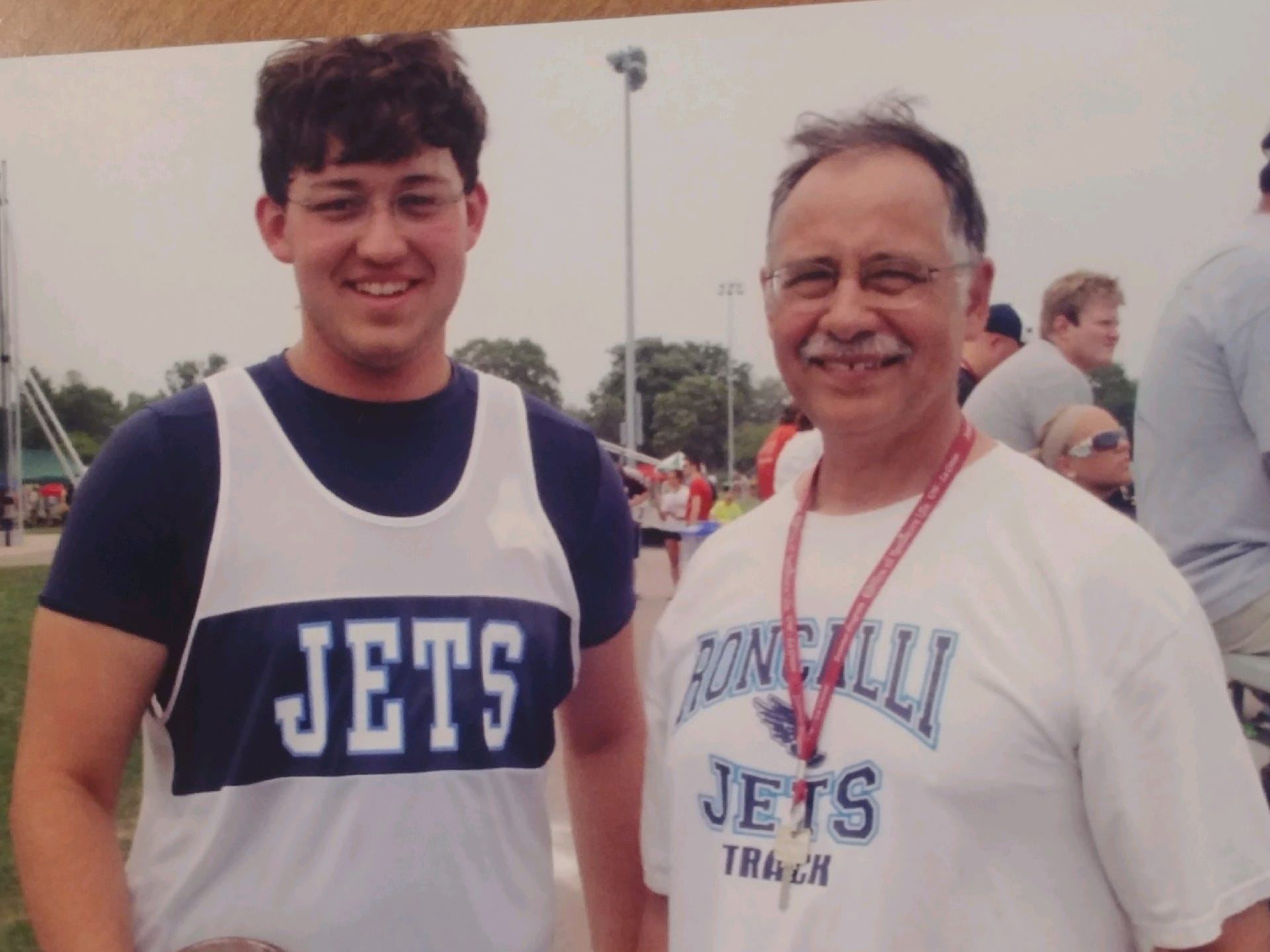 Chris Klein poses with Roncalli track and field coach Ray Baranczyk.