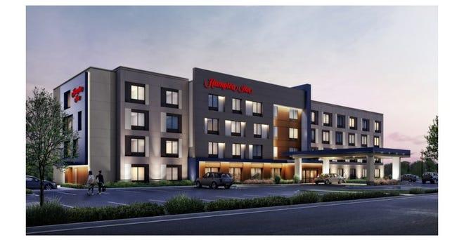 A rending of a Hampton Inn & Suites hotel.