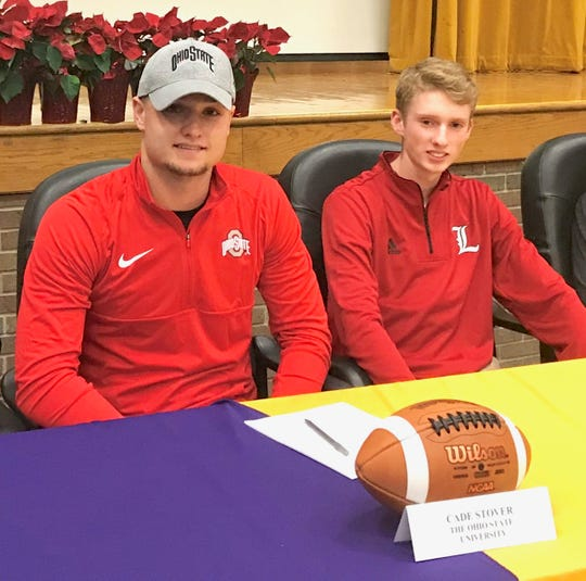 Best friends Cade Stover, left, and Kyle Johnston were among seven Lexington athletes signing with colleges on Wednesday. Stover, the reigning Mr. Football in Ohio, will continue his career at Ohio State. Johnston, a reigning state cross champion champ, will join his older brother Ryan at Louisville.