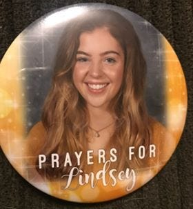 A picture of a button that were distributed during a prayer vigil at Shelby High School December 16, 2018.