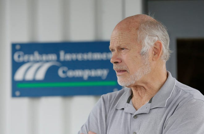 Ted Graham of the Graham Investment Company looks out on the Marion Intermodal Center that he recently sold. Picture taken on July 31, 2018.