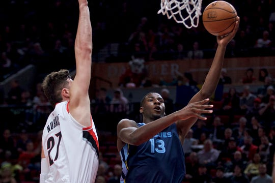 Memphis Grizzlies forward Jaren Jackson Jr., right, shoots over Portland Trail Blazers center Jusuf Nurkic during the first half of an NBA basketball game in Portland, Ore., Wednesday, Dec. 19, 2018. (AP Photo/Craig Mitchelldyer)