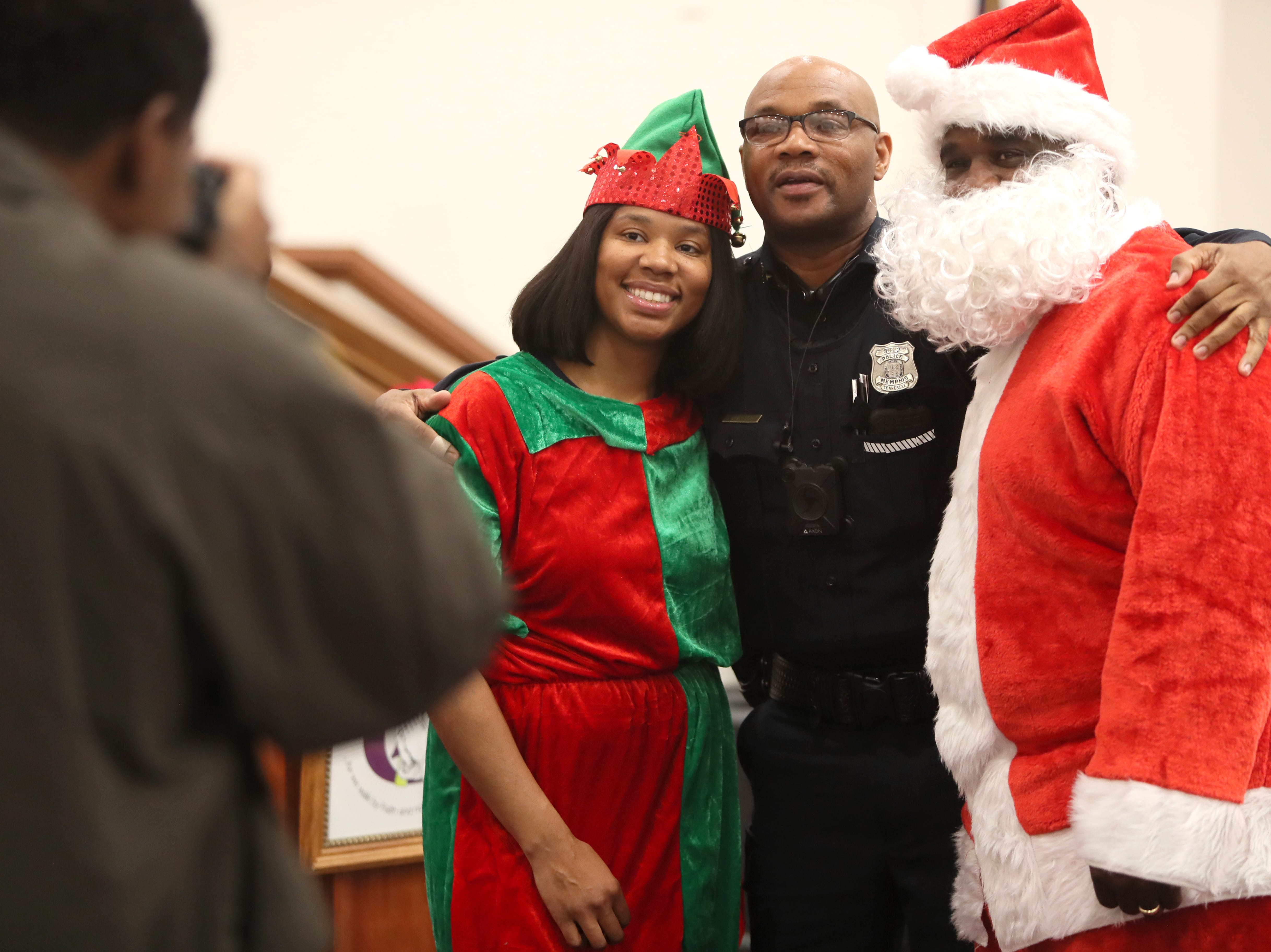 The Memphis Police Department's Community Outreach Program brings Christmas spirit with gifts and food to families at Grace Missionary Baptist Church on Thursday, Dec. 20, 2018.