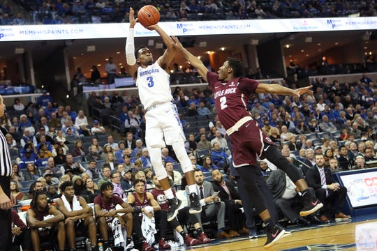 Memphis Tigers guard Jeremiah Martin shoots the ball over Arkansas-Little Rock Trojans guard Deondre Burns during their game at the FedExForum on Wednesday, Dec. 19, 2018.