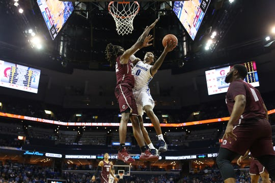 Memphis Tigers forward Kyvon Davenport shoots the ball over Arkansas-Little Rock Trojans forward Kris Bankston during their game at the FedExForum on Wednesday, Dec. 19, 2018.