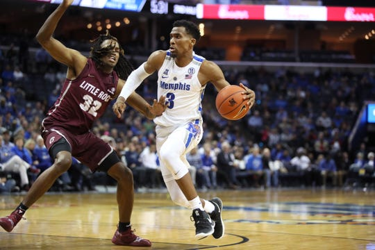 Memphis Tigers guard 	Jeremiah Martin drives past Arkansas-Little Rock Trojans forward Kris Bankston during their game at the FedExForum on Wednesday, Dec. 19, 2018.