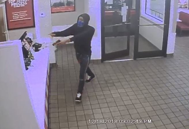 Police are looking for this male caught on camera robbing a Memphis KFC on Tuesday.