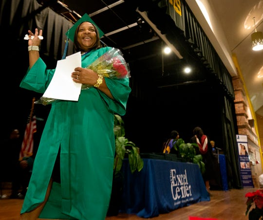Alice Savage, 66, waves after graduating from the Goodwill Excel Center General Education Diploma program.