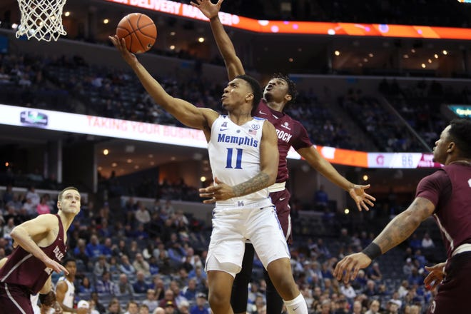 Memphis Tigers guard Antwann Jones lays the ball up past Arkansas-Little Rock Trojans guard Deondre Burns on Wednesday. Jones played a season-high 25 minutes and finished with 13 points, six assists, five rebounds and two blocks.