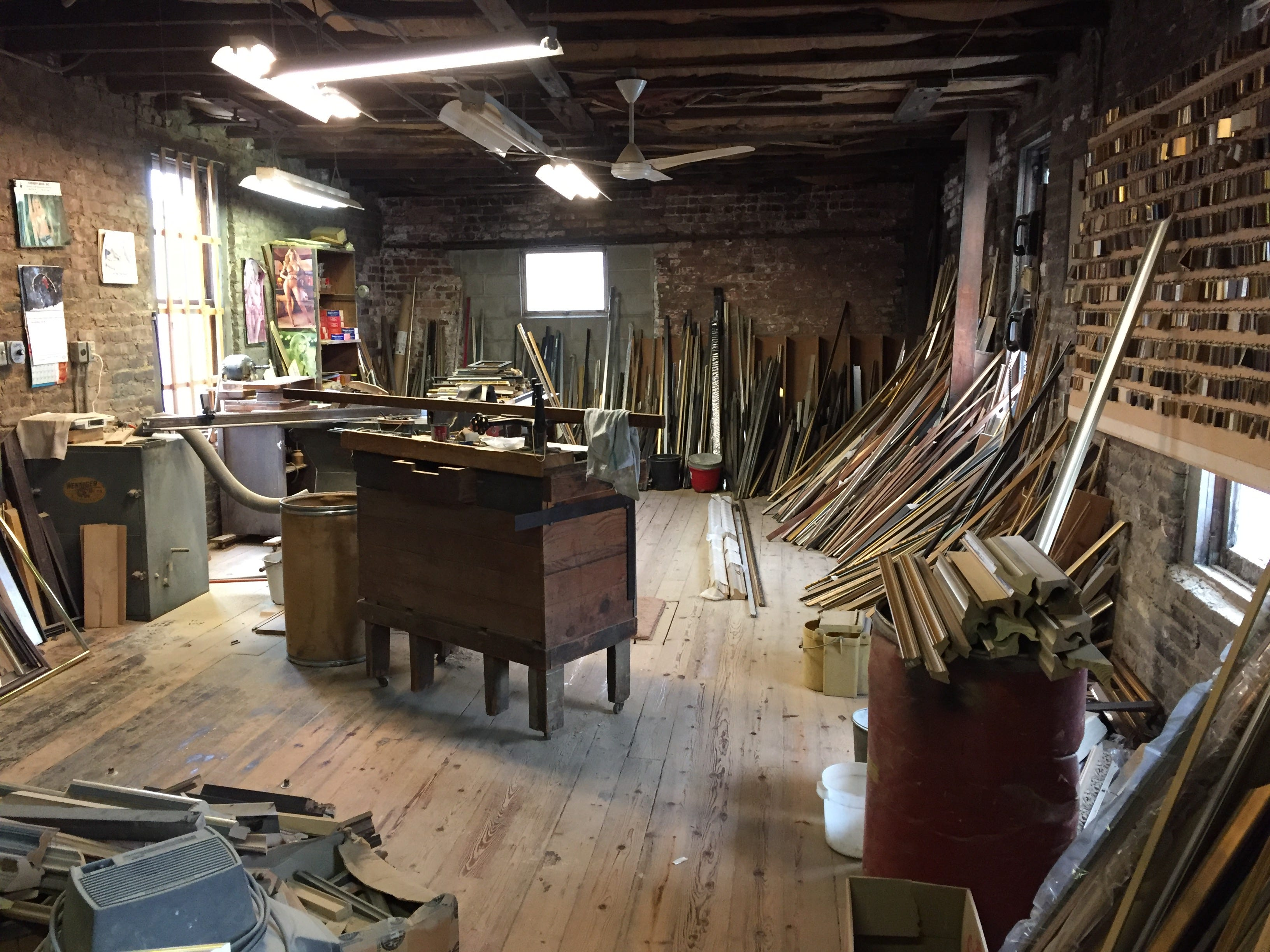 The second-floor workshop at Milwaukee Moulding & Frame is filled with materials.