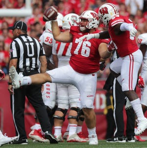 Wisconsin defensive lineman Kayden Lyles (76) celebrates his recovery of a fumble early this season. Lyles is preparing to move back to the offensive line next season.