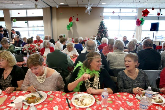 The Suttner family served more than 100 people at a seniors Christmas luncheon Dec. 19 at the YMCA at Pabst Farms in Oconomowoc.