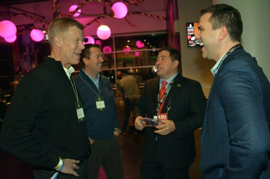 Milwaukee Bucks President Peter Feigin (center) chats with Lee Cooper, president and CEO of U.S. and Canada for GE Healthcare (left), Matt McLaughlin, chief financial officer for U.S. and Canada GE Healthcare, and Michael Belot, senior vice president of Bucks ventures and development at Fiserv Forum.