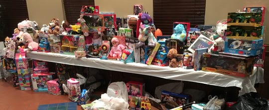 The Milwaukee Area Parrothead Association brought in 250 toys valued at about $4,000 for the Fox Company, 2nd Battalion, 24th Marine Regiment's Toys for Tots program through their Winter Luau Toys for Tots Christmas Party this year.