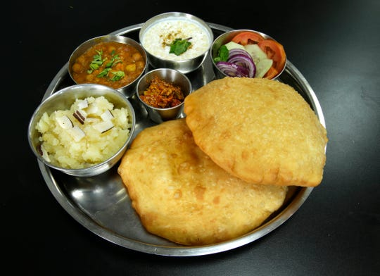 The Punjabi dish chole bhature is served as a combo plate at the small counter-service Indian Delight, at 140 E. Drexel Ave. in Oak Creek. Besides chickpea curry and fried bread, it's served with sauce, pickles and a sweet.