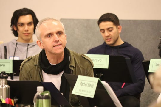 "Gregory Linington (foreground) portrays aggressive financier Bob Merkin in Milwaukee Repertory Theater's production of ""Junk."" Brookfield Central alum Ayad Akhtar wrote the play."