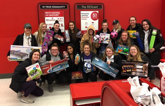 The softball team at University of Wisconsin-Whitewater buys toys and gifts for other kids in the community instead of gifts to themselves.
