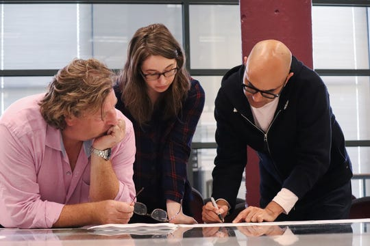 "Director Mark Clements (left) and dramaturg Deanie Vallone confer with playwright Ayad Akhtar about ""Junk."" The Milwaukee Repertory Theater's production begins Jan. 15."