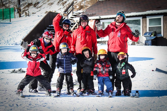 Ski instructors and their young students goof around at Tyrol Basin in Mount Horeb.