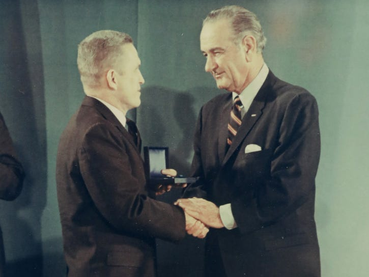 This signed photo from President Lyndon Johnson (right) shows Johnson presenting astronaut Frank Borman an award in 1968.