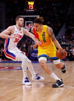 Bucks forward D.J. Wilson drives on Pistons forward Jon Leuer on Monday.