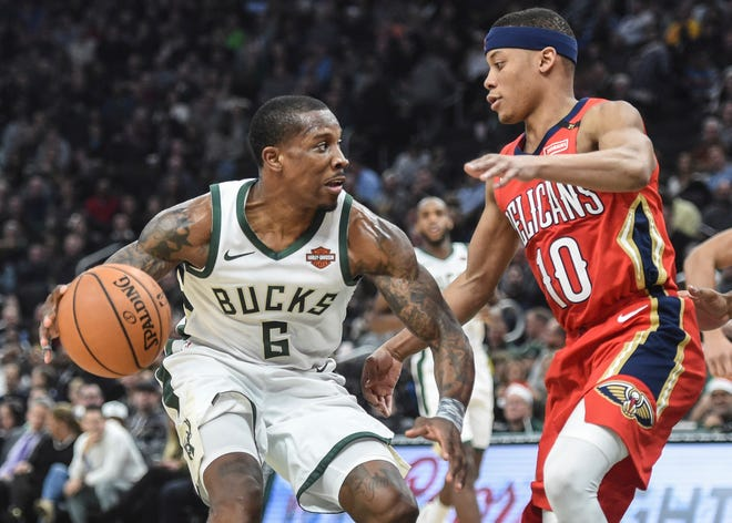 Tim Frazier (right), who was with the Bucks in training camp, is returning to the team to shore up the guard corps.