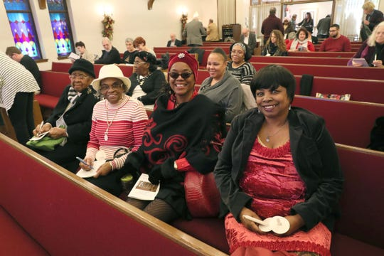 Mary Hard (from left), Callie Simmons and sisters Cheryl Johnson and Brenda Johnson take their seats for the service.