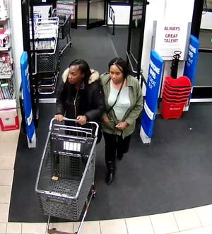 The woman wearing the black coat is suspected of assaulting a Burlington Coat Factory employee.
