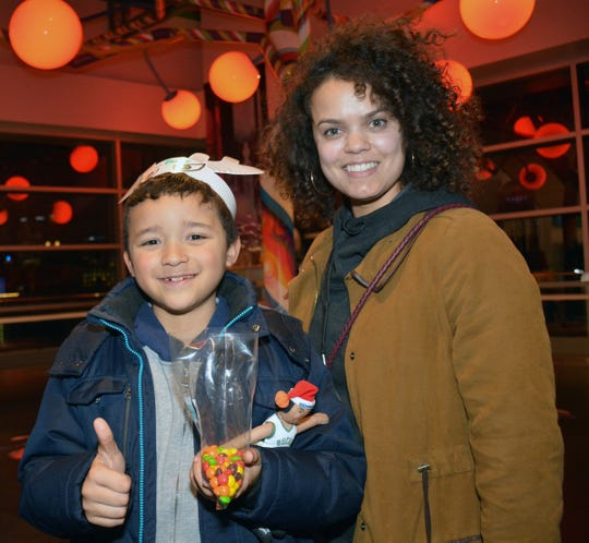Hezziah Richardson, 9, and Jenifer Torres at the Candy Lab, a new store at Fiserv Forum. The store is located at the top of the escalator on the upper concourse and opened earlier this month.