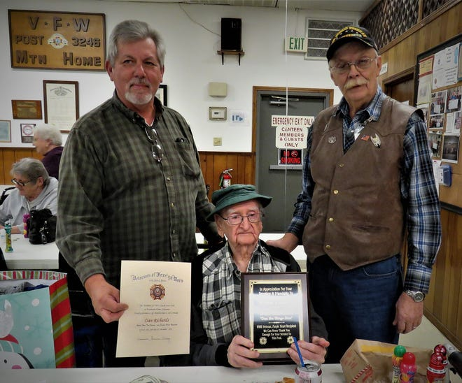 Veterans of Foreign Wars Post 3246 recently presented U.S. Marine Corps veteran Dan Richards (seated) with a certificate of appreciation and a plaque honoring his service. Richards is a World War II veteran and received a Purple Heart. Richards said he enjoys visiting the VFW and playing bingo. Joining him in the above photo are Post Commander Ronnie Young (left) and bingo coordinator Charles Wensel.