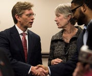 State Superintendent Eric Mackey speaks with Montgomery Education foundation executive director Ann Sikes and director of innovation Justin Hampton following a press conference at the Alabama State Department of Education in Montgomery, Ala., on Thursday, Dec. 20, 2018.