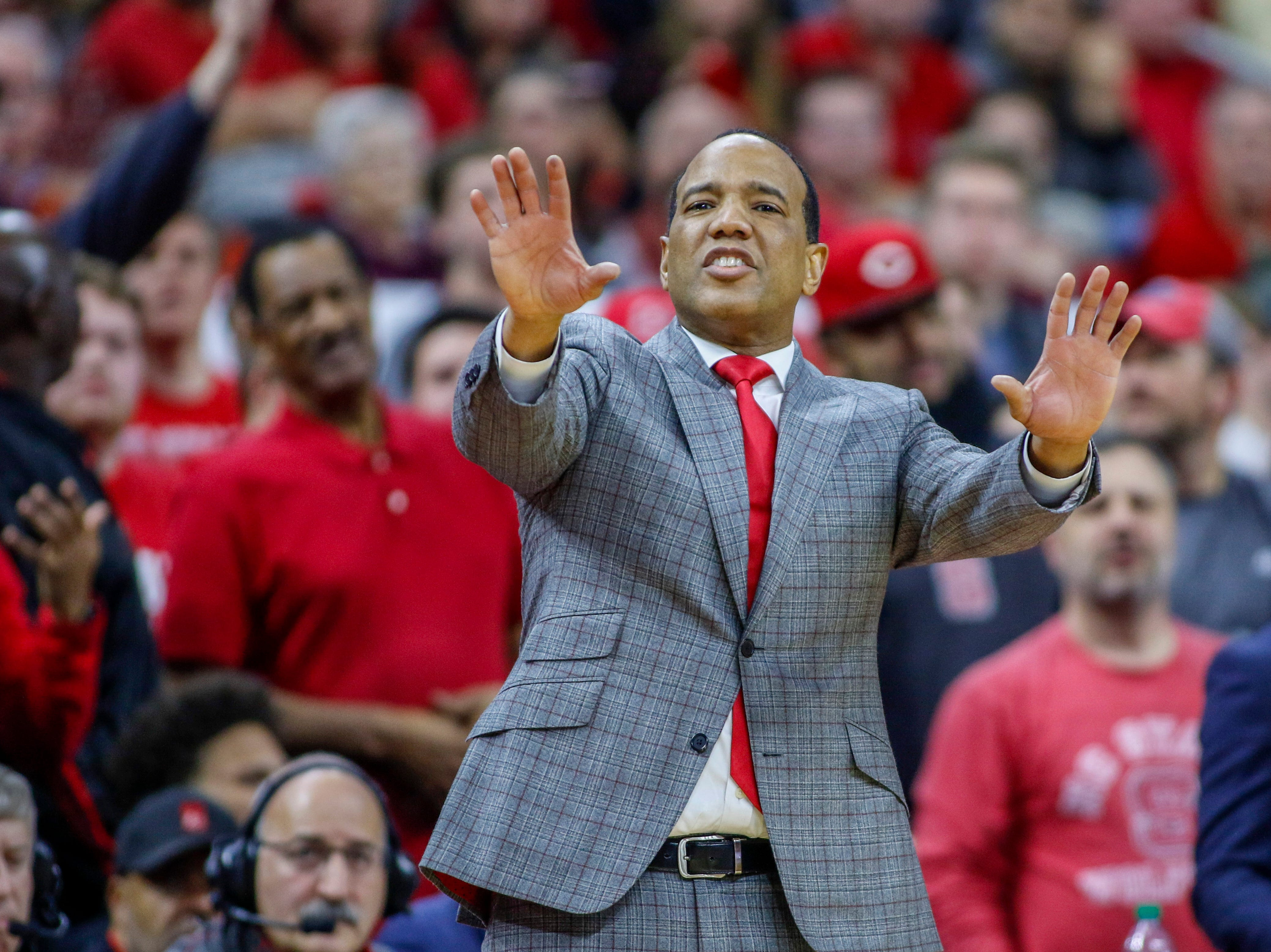 Dec 19, 2018; Raleigh, NC, USA; North Carolina State Wolfpack head coach Kevin Keatts directs his team as they play against the Auburn Tigers in the second half at PNC Arena. The North Carolina State Wolfpack won 78-71. Mandatory Credit: Nell Redmond-USA TODAY Sports