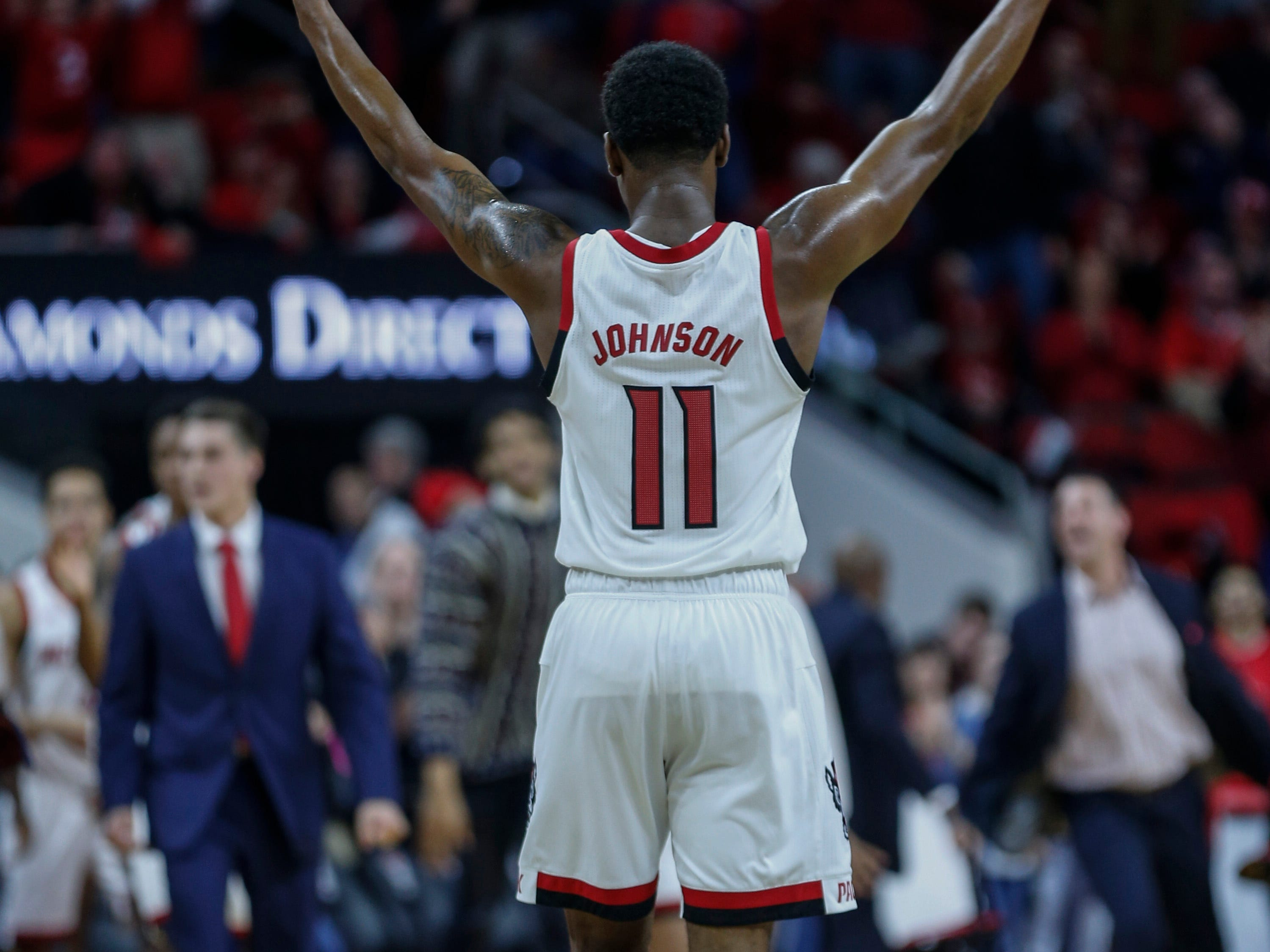 Dec 19, 2018; Raleigh, NC, USA; North Carolina State Wolfpack guard Markell Johnson celebrates as the Wolfpack defeat the Auburn Tigers 78-71 at PNC Arena.  Mandatory Credit: Nell Redmond-USA TODAY Sports